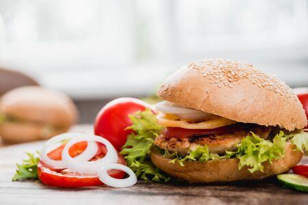 Beautiful big hamburger on a wooden table. Imagens