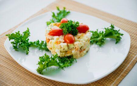 Fresh vegetable salad on the white plate. Restaurant.