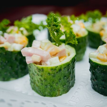 Salad in the cucumber basket. Catering. Restaurant. Stockfoto