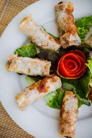 Fresh vegetable salad on the white plate. Restaurant 写真素材