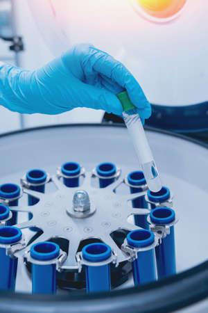 Modern medical laboratory centrifuge. Light medical background.