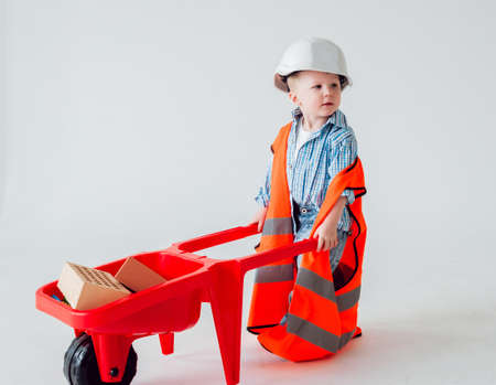 Little boy on the white background. Construction