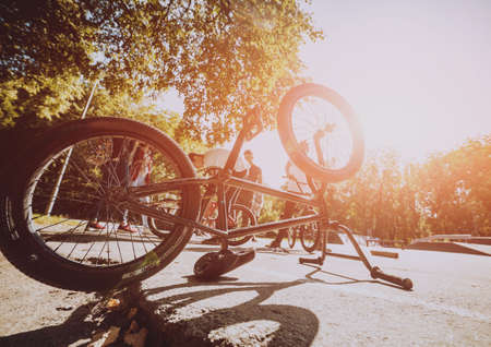 Bmx bicycles lays on the ground in the skatepark. Bicycle repair