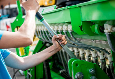 The mechanics repair combine harvester. Modern agricultural machinery and equipment. Industrial details. 写真素材