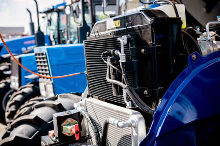 Modern new agricultural tractor engine. Machinery and equipment. Industrial details.