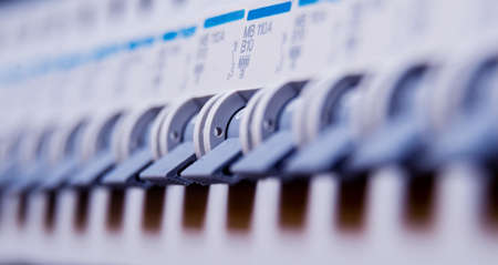 Voltage switchboard with circuit breakers. Electrical background Banque d'images