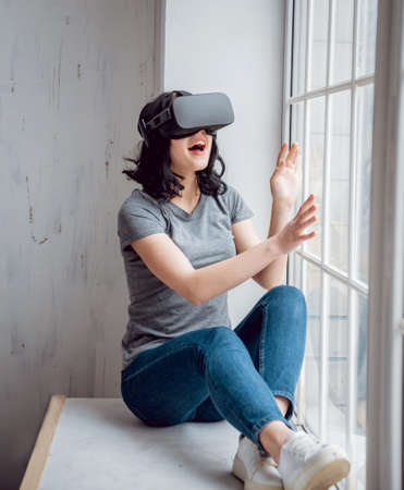 The beautifull girl wearing virtual reality goggles