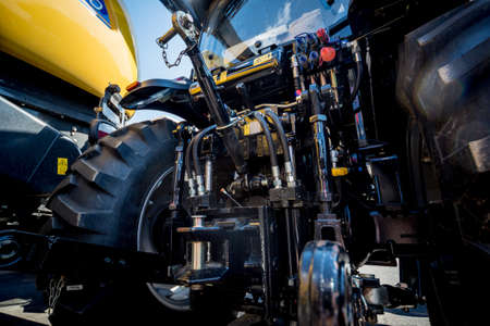 Rear view of modern agricultural tractor. Industrial details.
