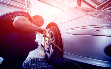 Automotive suspension test and brake test rolls in a auto repair service. Stock Photo