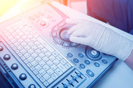Ultrasound equipment. Sonography diagnostics. Light medical background. Stock Photo