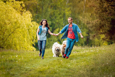 Young couple with the dogs in the park