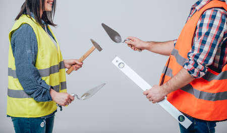 Hands holding tools for home renovation. Background
