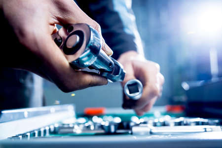 Tools at the hands. Auto repair service Stock Photo