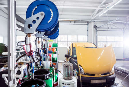 Changing the oil in auto repair service. Auto service