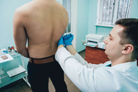 Man with health problems visiting urologist. Clinic