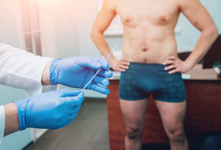 Man with health problems visiting urologist. Clinic Imagens