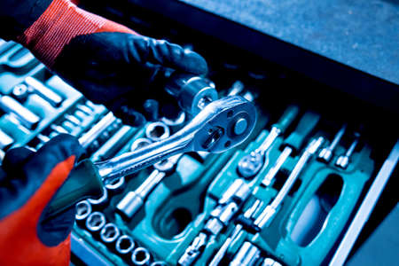 Tools at the hands. Auto repair service