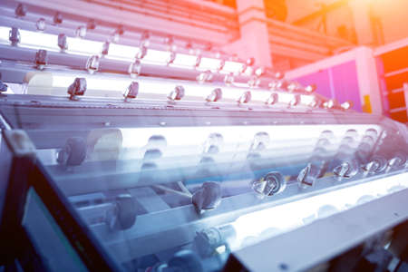 Conveyor belt for production a window pane. Industrial equipment. Stock Photo