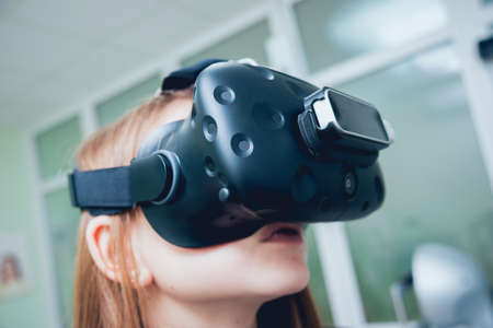 Eye treatment. Patient in virtual reality goggles.
