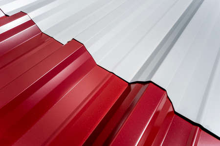 Red and white metallic roof tiles background with drops of water. Stock fotó