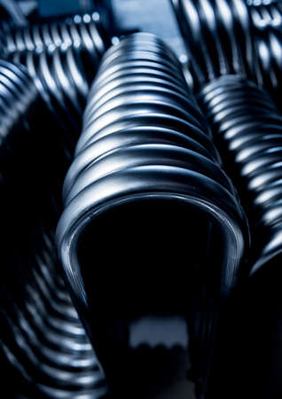 Abstract industrial background of metal pipes construction.