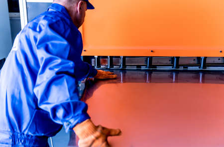 The technician operator use hydraulic bending machine