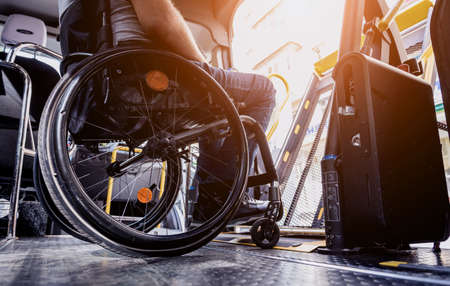 A man in a wheelchair inside of a specialized vehicle