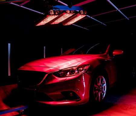 Infrared lamps for drying of car body parts after applying save gloss coating Imagens