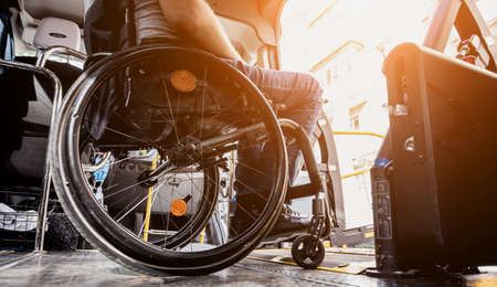 A man in a wheelchair inside of a specialized vehicle Stockfoto