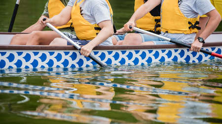 People with disabilities sail on a rowing boat. Stock fotó