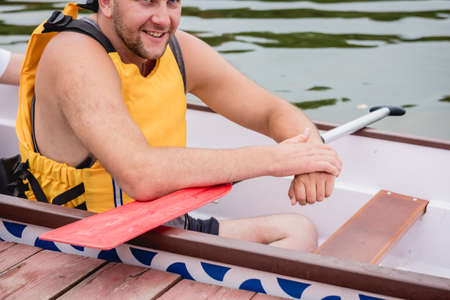 People with disabilities sail on a rowing boat.