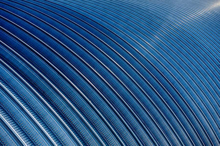 The surface of a industrial metal roof. Abstract background Standard-Bild