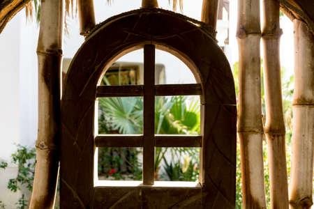 Old wooden doors at the beautiful tropical garden