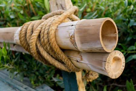 Bamboo poles tied by a thick rope Standard-Bild