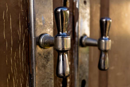 metal rustic door handles at wooden brown doors