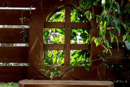 Old wooden window at the beautiful tropical garden Standard-Bild