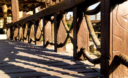 Beautiful old wooden bridge at the park