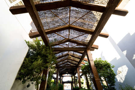 Old wooden roof at the beautiful tropical garden Standard-Bild
