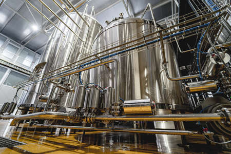 Rows of steel tanks for beer fermentation and maturation in a craft brewery 版權商用圖片