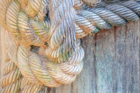 a rope tied to a knot on the pier