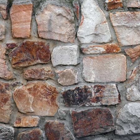 masonry wall paving stones as a background close up. High quality photo