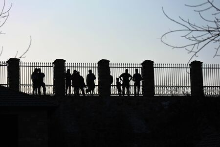 people standing behind the fence as background. High quality photo Archivio Fotografico