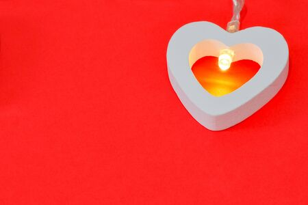 garland of hearts on a red background for Valentine's day. High quality photo Фото со стока