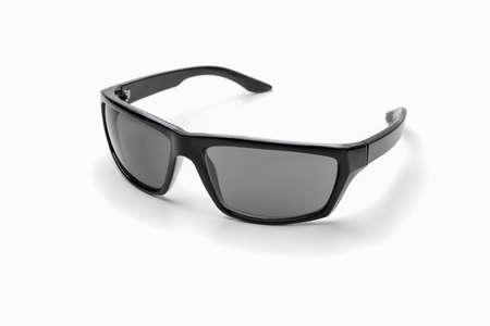 black sunglasses on a white background isolate Фото со стока