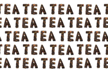 colorful pattern of words from tea on a black background top view Фото со стока