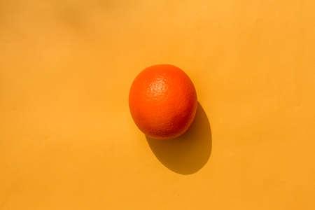 orange on a yellow background. hard shadow. isolate