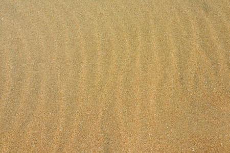 Sand on the beach as background. Dune sand Фото со стока