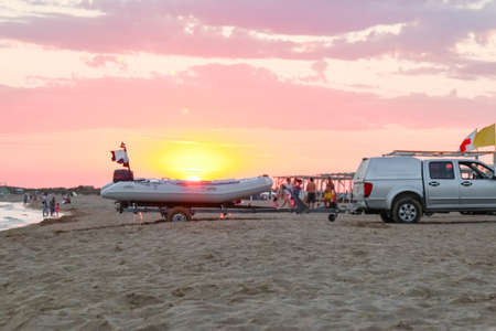 transporting a motor boat out of the water on the beach Фото со стока