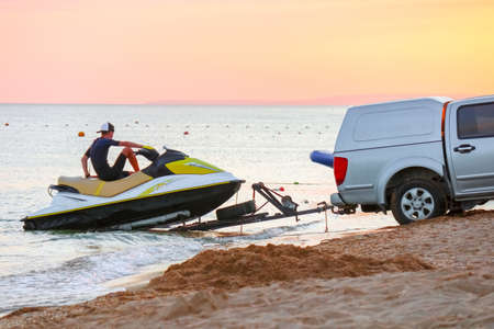 towing a jet ski to the shore