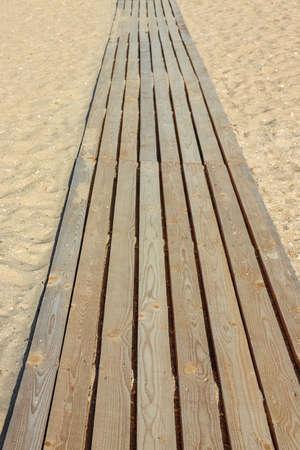 wooden path on the beach dune sand